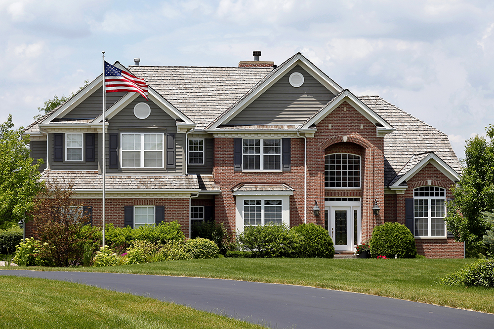 Brick house with an American flag seen during a home inspection